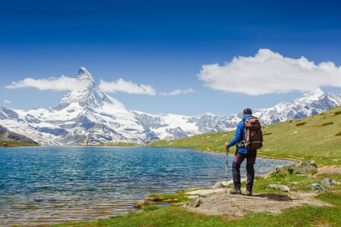 hiker-with-backpack-on-the-triail-near-Matterhorn